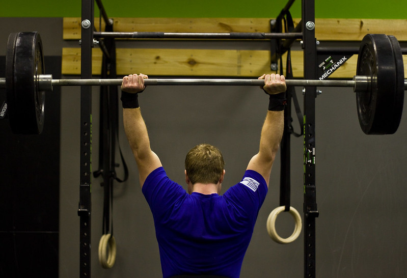 A Man Performing the Overhead Barbell Press