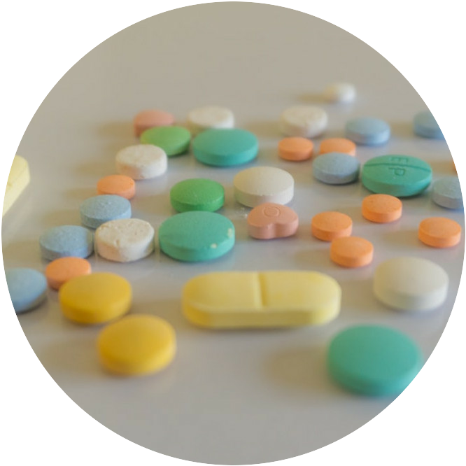 A selection of different colored pills and medication