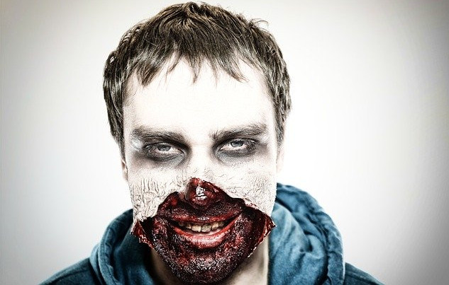 A man with the bottom half of his face torn off smiling scarily