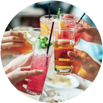 "4 people's hands giving a ""cheers"" while holding alcoholic drinks"