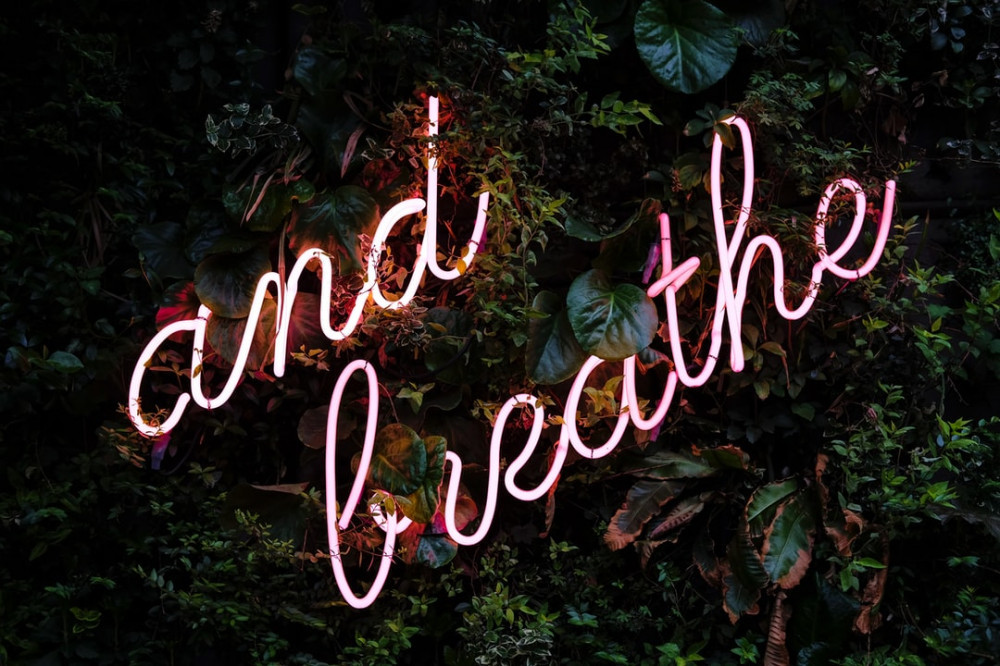 """and breathe"" written in neon lights"