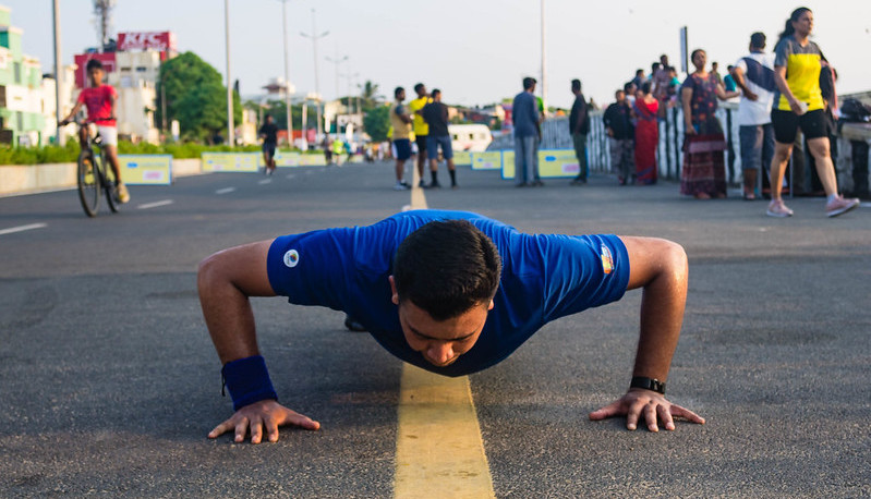 A Man Doing Push Ups in the Road