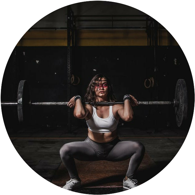 A woman performing a barbell front squat