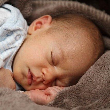 A baby lies asleep
