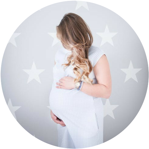 A pregnant woman wearing a white dress and holding her bump. There are white stars in the background.