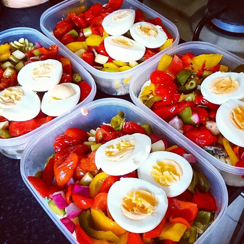 4 Portions of Boiled Egg, Roasted Pepper, and Tomato Salad