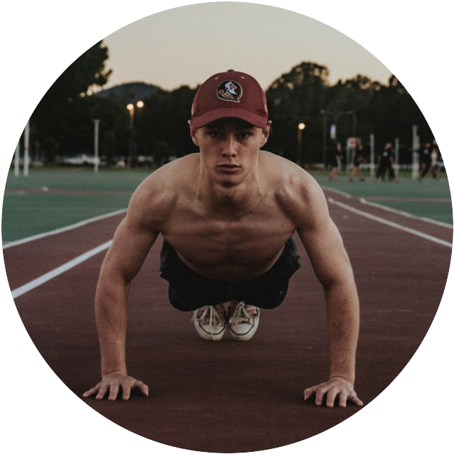 A man on a racing track in top part of a push up