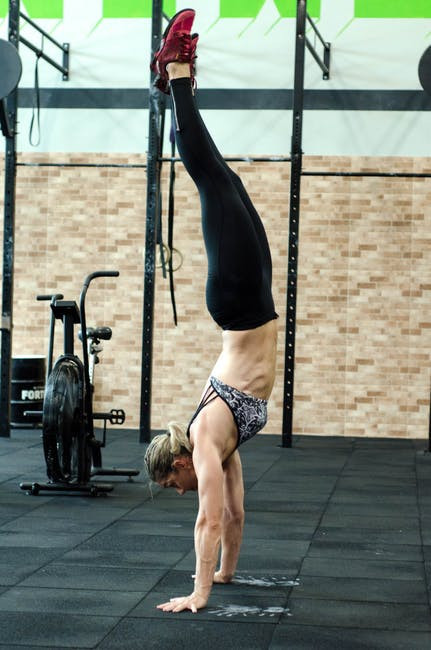 A woman performing a handstand