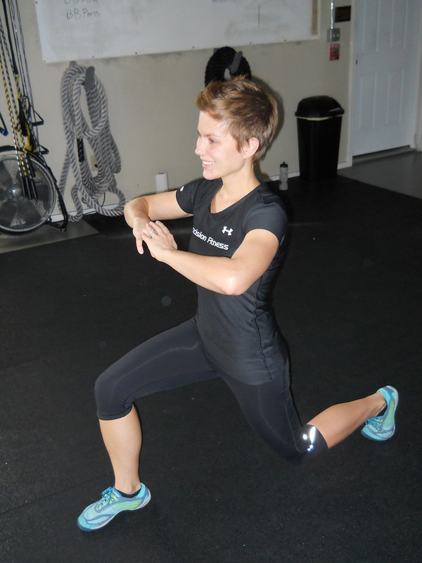 A woman performing lunges