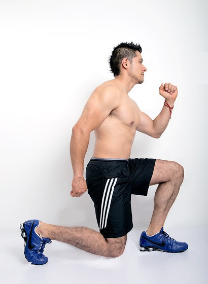 A man peforming the lunge exercise