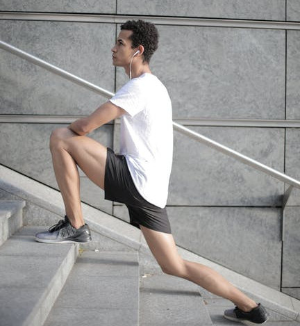 A Man Climbing A Set of Stairs By Lunging