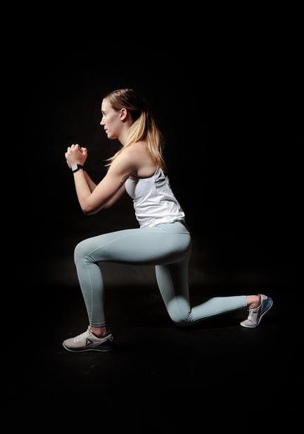 A Woman Performing The Lunge Exercise