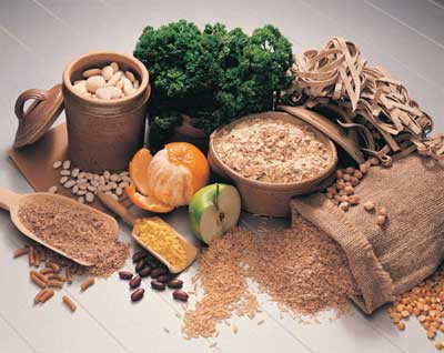 A selection of carbohydrates such as wheat, rice, fruits and vegetables
