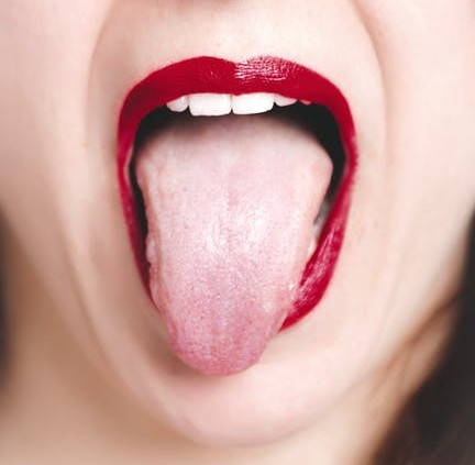 A woman sticking out her tongue