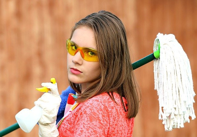 Chores for kids by age - sassy girl with mop