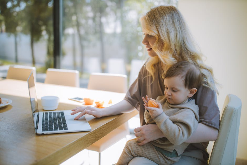 going back to work after having baby - mother working with child