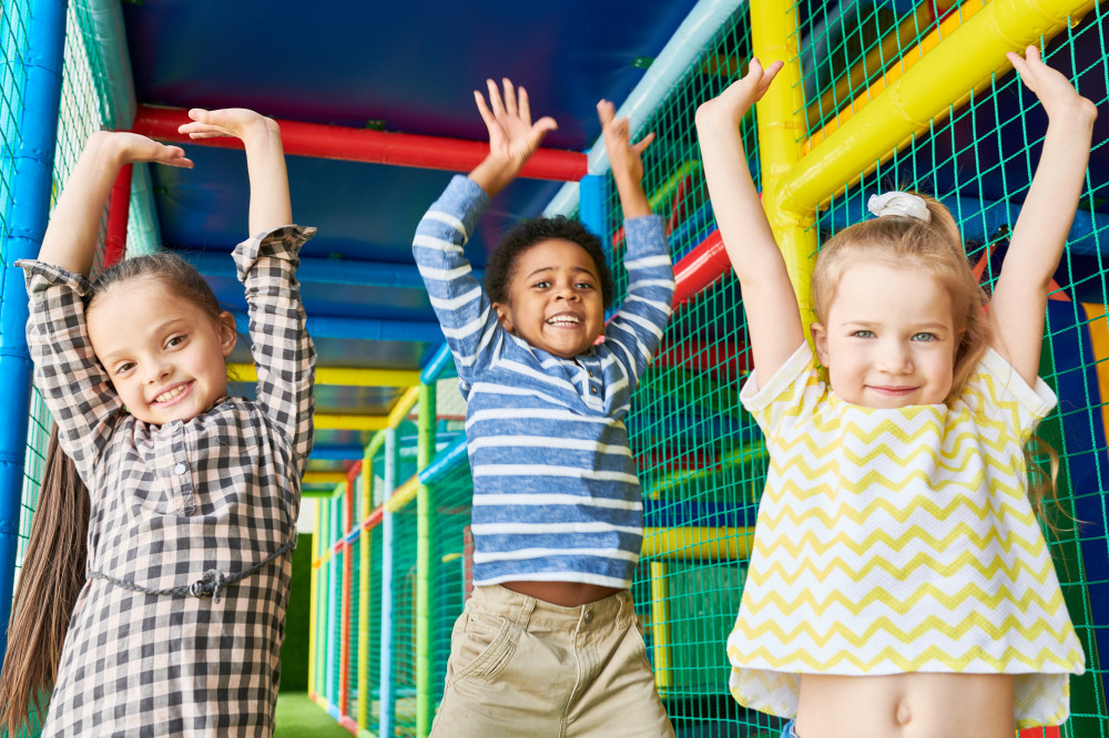 Children with arms up in the air