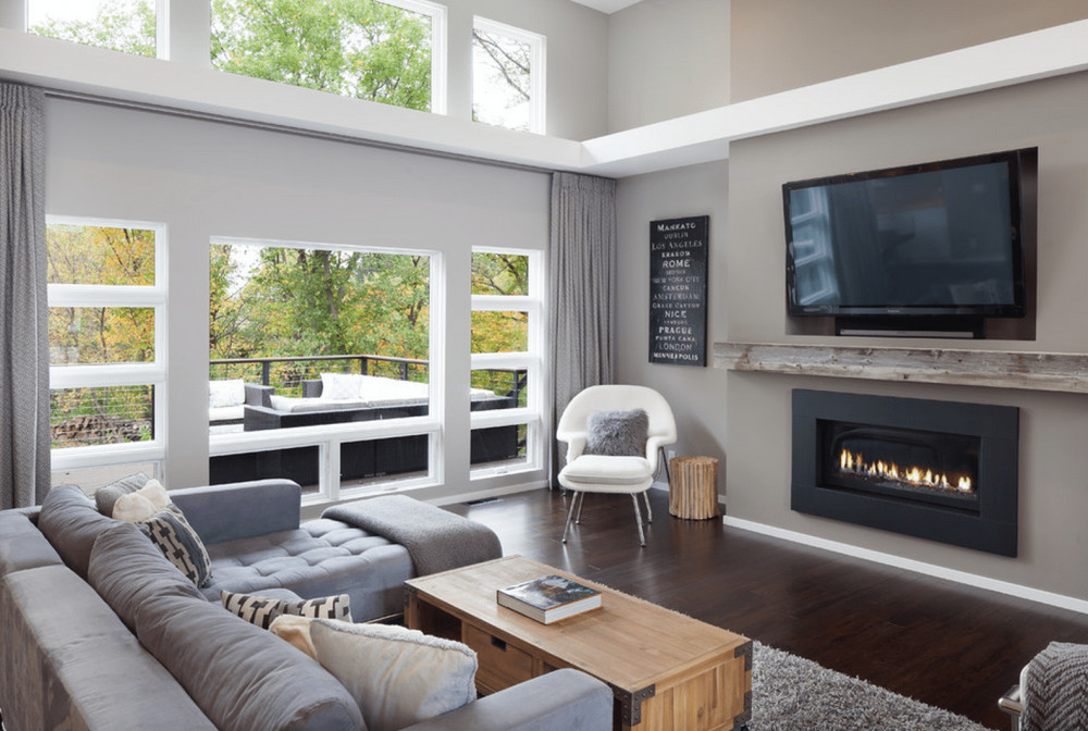 Large windows and wooden floors in gray living room