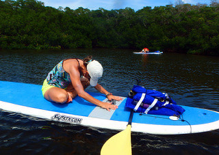 Seated Pose on Paddle Board