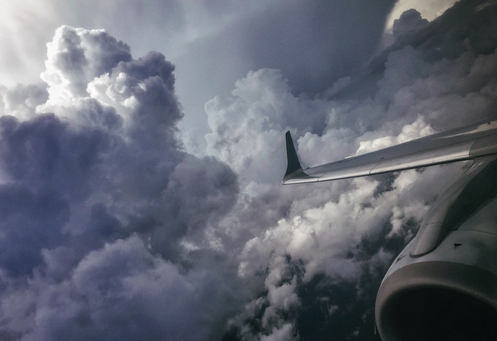 aircraft flying close to turbulent storm