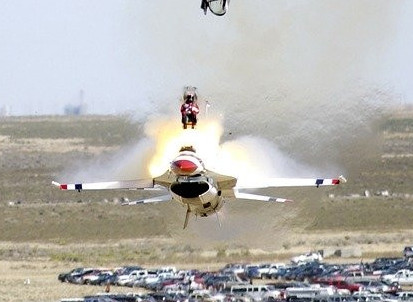 fighter pilot ejecting from plane