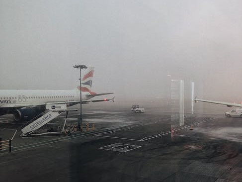planes at airport when it is raining