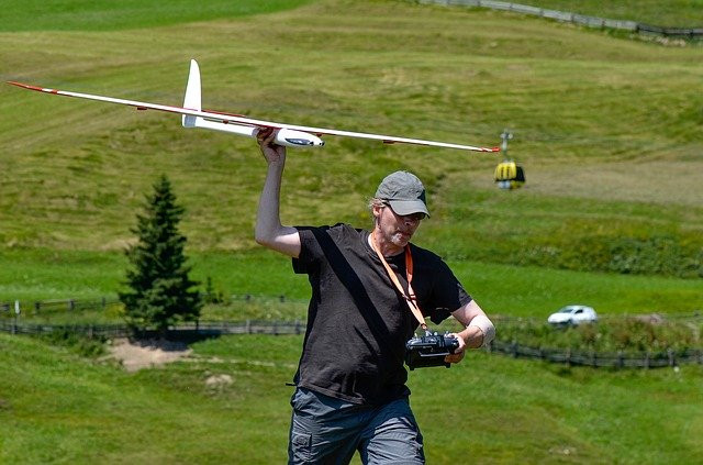 man about to throw RC airplane