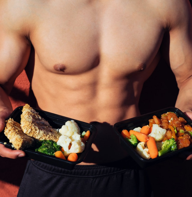 Muscular man preparing to eat healthy meals postworkout