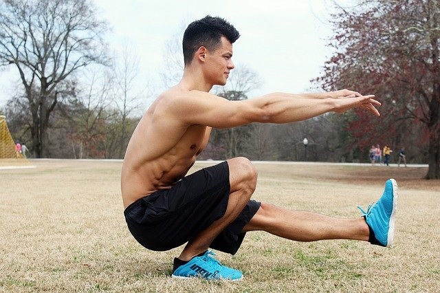A-shirtless-guy-performing-bodyweight-training-outside