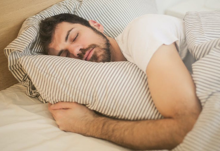 Man-in-bed-asleep