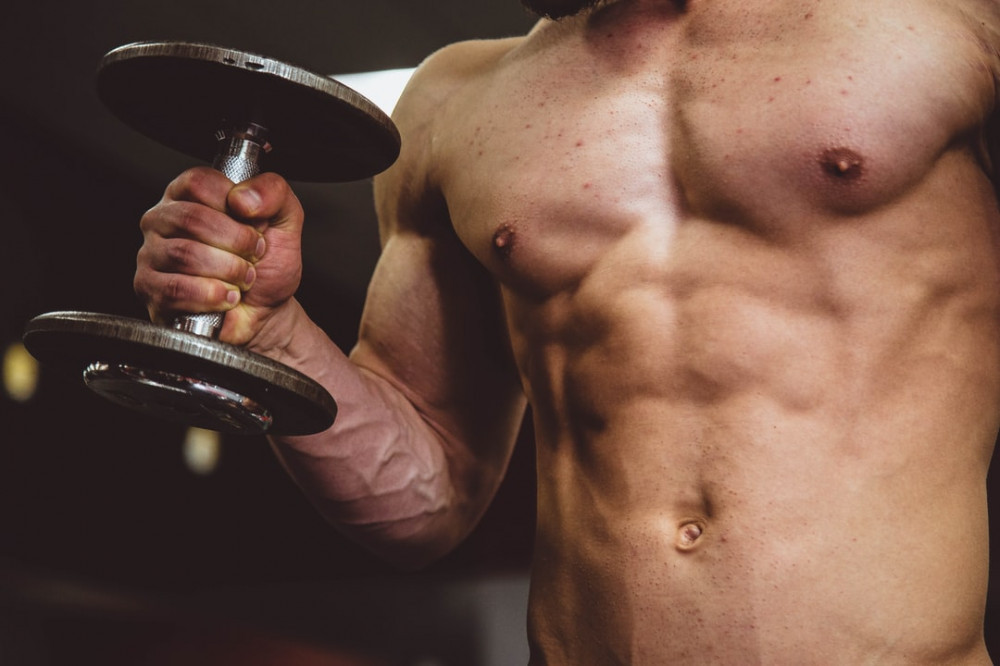 The-torso-section-of-a-man-holding-a-dumbbell