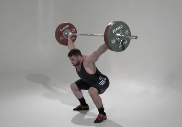 Man performing the catch element of the snatch lift