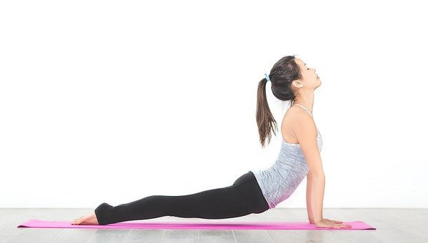 A-woman-performing-the-cobra-abdominal-stretch