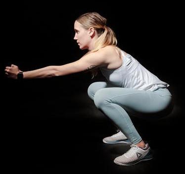 A-woman-performing-a-squat