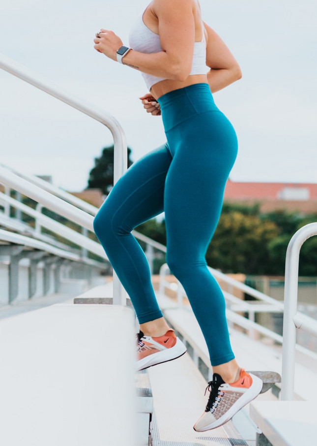A-woman-running-up-steps-wearing-sportswear