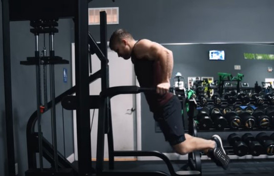 Man-performing-chest-dips