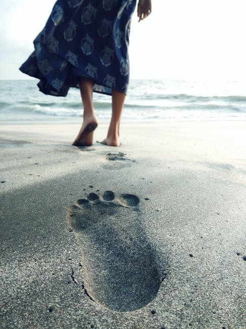 footprint in sand on the beach