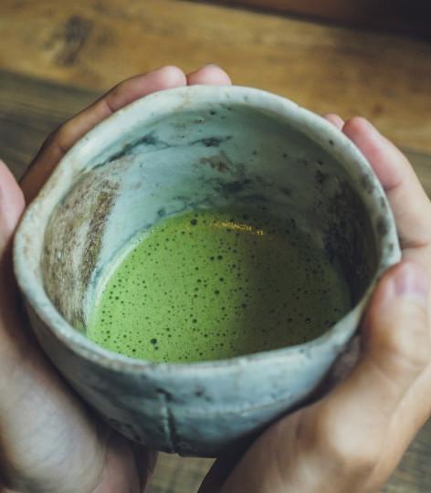 Man cupping a Bowl of Matcha Tea.