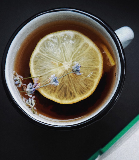 A cup of Tea with Lemon Slice on top.