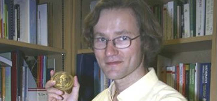Rollo Carpenter holding one of his two Loebner Prize Medals.
