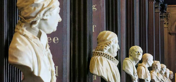 The busts of famous figures line a University Library.