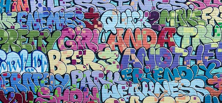 Graffiti image of words painted on a wall.