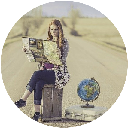 female traveller on the road with a map and a globus