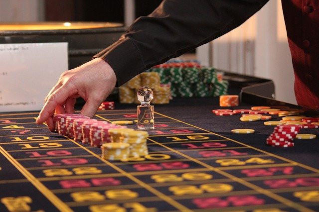 croupier's hands around chips and dolly croupier training school