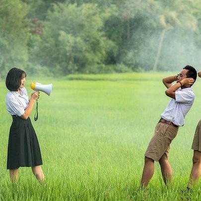 a lady screaming through megaphone