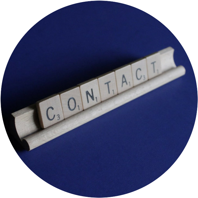 the word contact made from scrabble tiles
