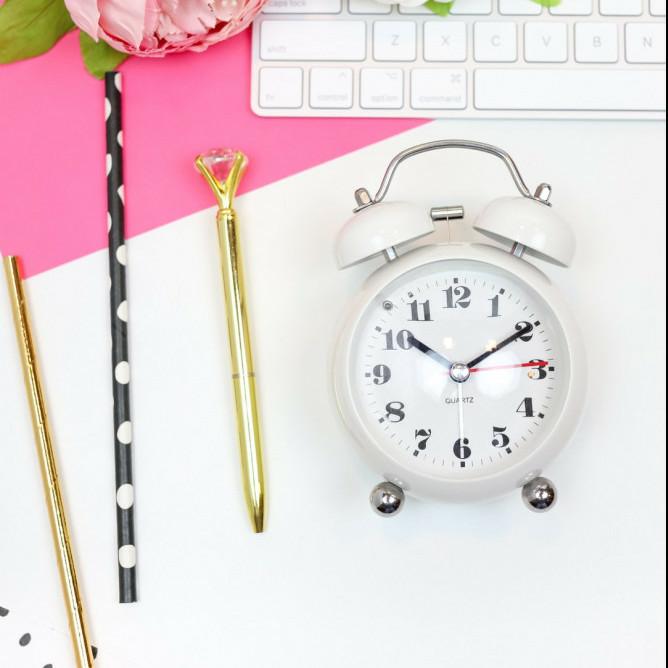 alarm clock, pens and laptop