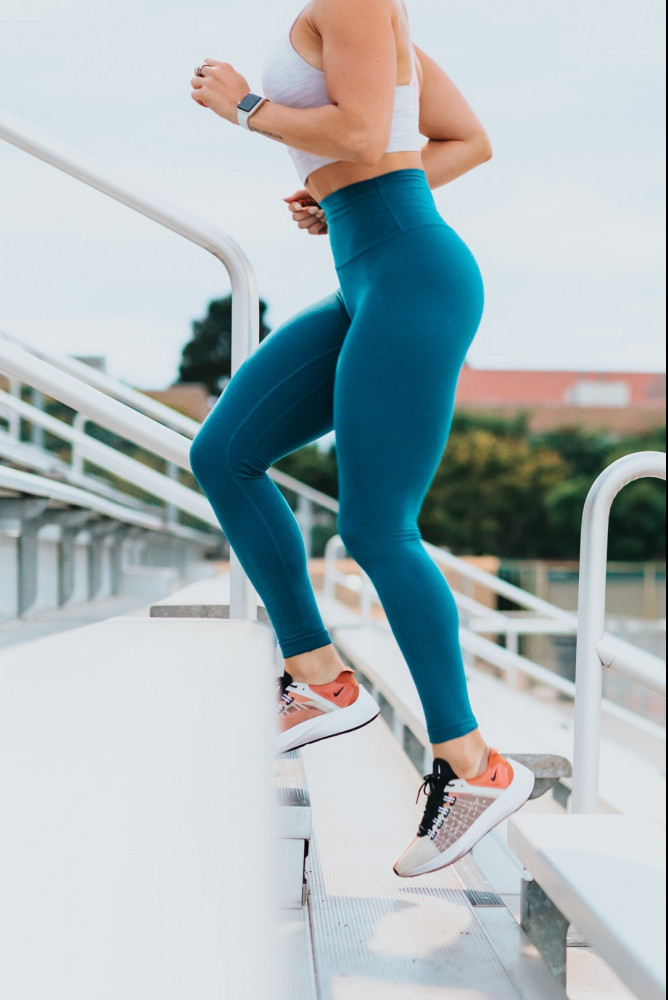 Women performing cardio on stairs to show that the 10 best home workouts can be done anywhere