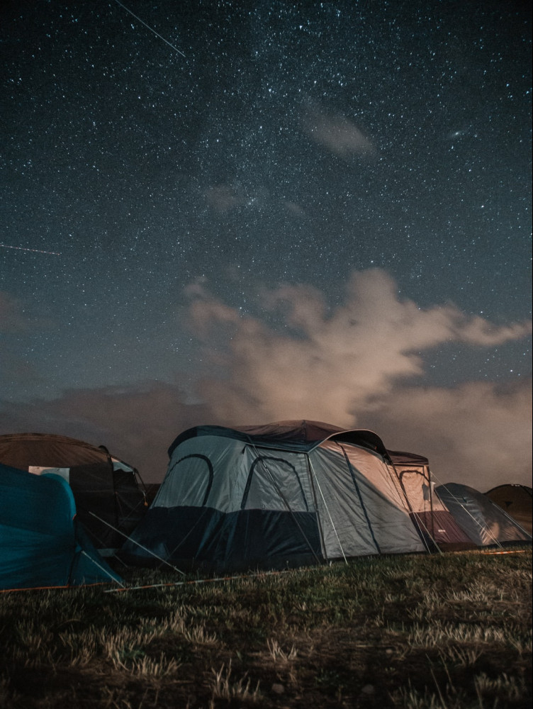 tents in the night, stars above