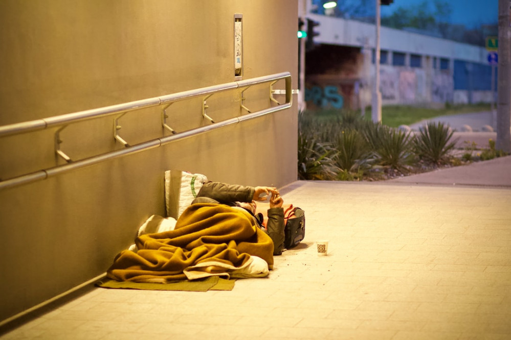 a person sleeping outside, poverty